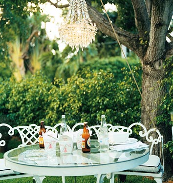 Outdoor dining-crystal chandelier_outdoor_rooms_may06_domino mag